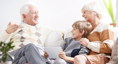 Grandparents with their grandson using a tablet